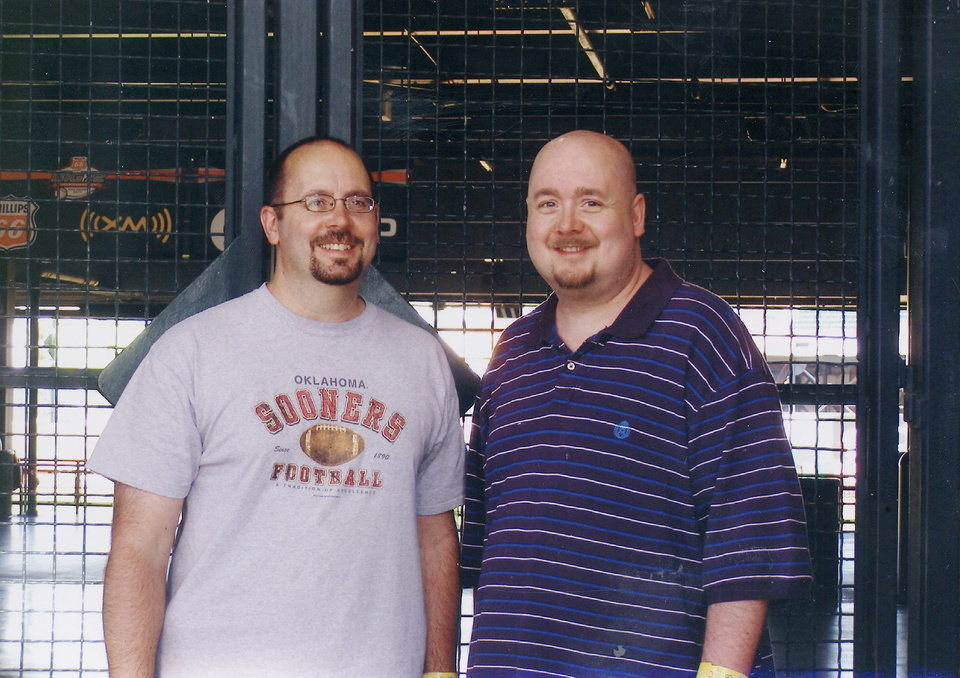 Photo - Oklahoman reporter Ken Raymond. I look massive beside my brother, Ron, at the Bricktown Ballpark last summer. He's the handsome devil on the left. Photo Provided by Ken Raymond ORG XMIT: KOD
