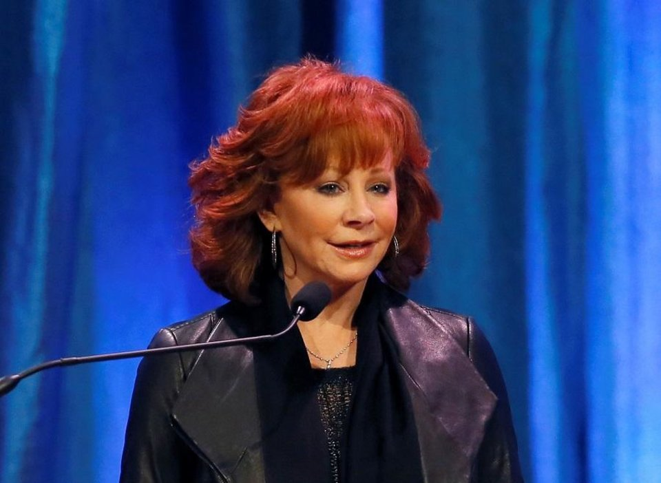 Photo - Reba McEntire speaks as she and the rest of the McEntire family accept the 2019 Hall of Great Westerners award for the late Clark McEntire during the National Cowboy & Western Heritage Museum's Western Heritage Awards in Oklahoma City, Saturday, April 13, 2019. [Bryan Terry/The Oklahoman Archives]