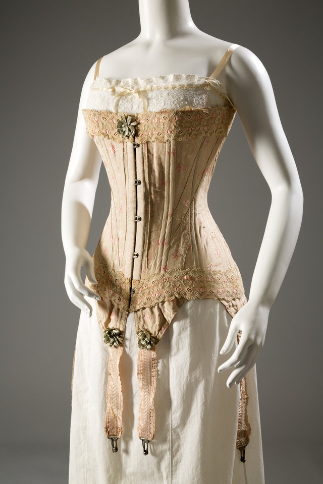 Photo - This image released by The Museum at FIT shows Corset, floral brocaded silk, silk ribbon, elastic, circa 1905, England. From a 1770 corset to a 2014 bra-and-panty set in lacy stretch silk, the Museum at the Fashion Institute of Technology has taken on lingerie and ladies foundation garments as the focus of a new exhibition. In about 70 pieces,