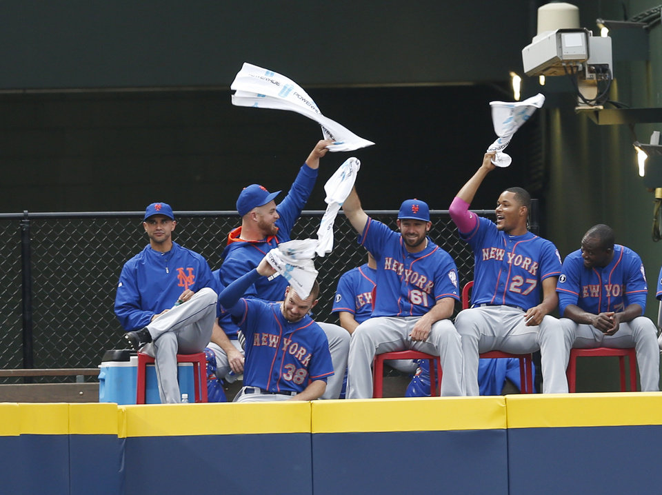Photo - The New York Mets bullpen wave towels as they celebrate a base hit by New York Mets second baseman Daniel Murphy (28) in the third inning of a baseball game against the Atlanta Braves in Atlanta, Monday, June 30, 2014. (AP Photo/John Bazemore)