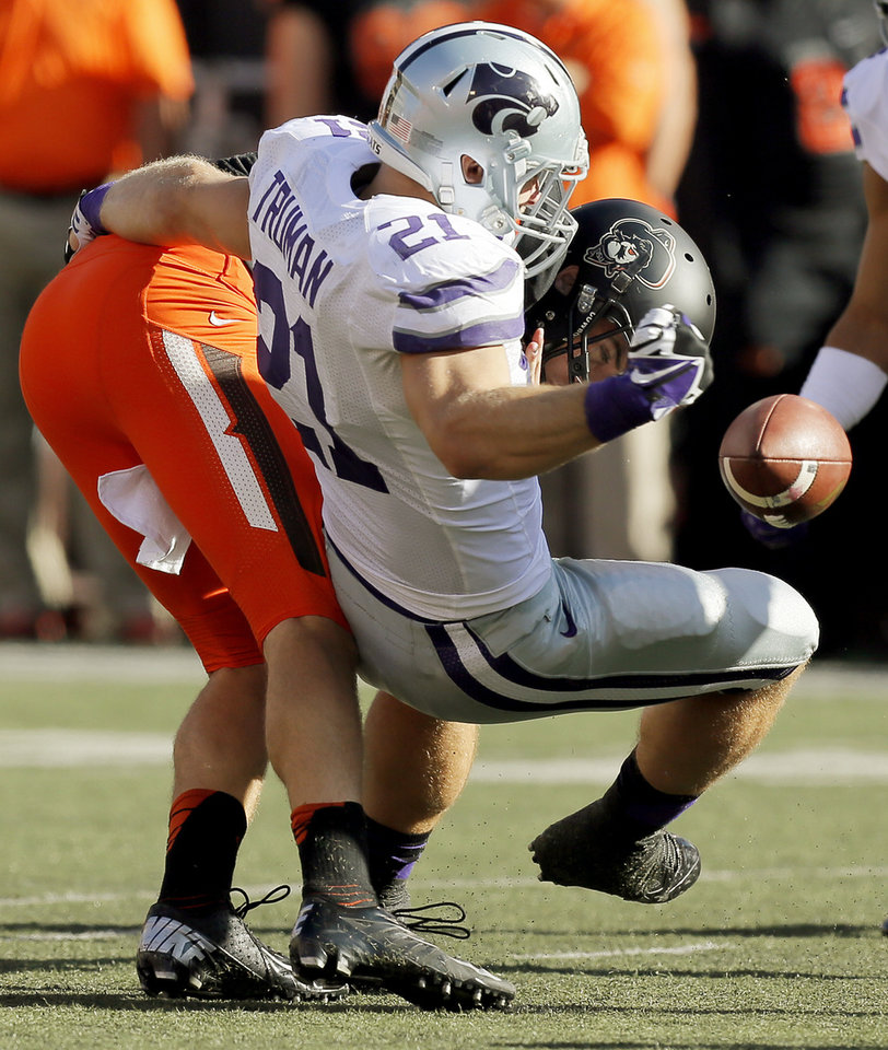 Kansas State's Jonathan Truman (21) forces a fumble by Oklahoma State's J.W. Walsh (4) in the third quarter during a college football game between the Oklahoma State University Cowboys (OSU) and the Kansas State University Wildcats (KSU) at Boone Pickens Stadium in Stillwater, Okla., Saturday, Oct. 5, 2013. OSU won, 33-29. Photo by Nate Billings, The Oklahoman