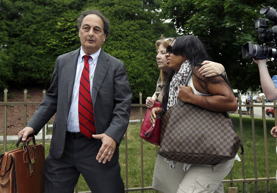 Photo - Shayanna Jenkins, right, fiancee of former New England Patriots football player Aaron Hernandez, is escorted by attorneys Janice Bassil and James Sultan, left, after a bail hearing in Fall River Superior Court Thursday, June 27, 2013, in Fall River, Mass. Hernandez, charged with murdering Odin Lloyd, a 27-year-old semi-pro football player, was denied bail. (AP Photo/Elise Amendola)