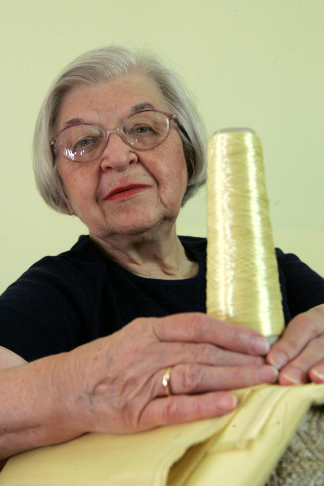 Photo - FILE - Stephanie Kwolek   poses for a photo holding with a spool of Kevlar, in this June 20 2007 file photo taken in Brandywine Hundred, Del. Her friend, Rita Vasta, told The Associated Press that Stephanie Kwolek died Wednesday June 18, 2014 in a Wilmington hospital. She was 90.  (AP Photo/The News Journal, Jennifer Corbett)