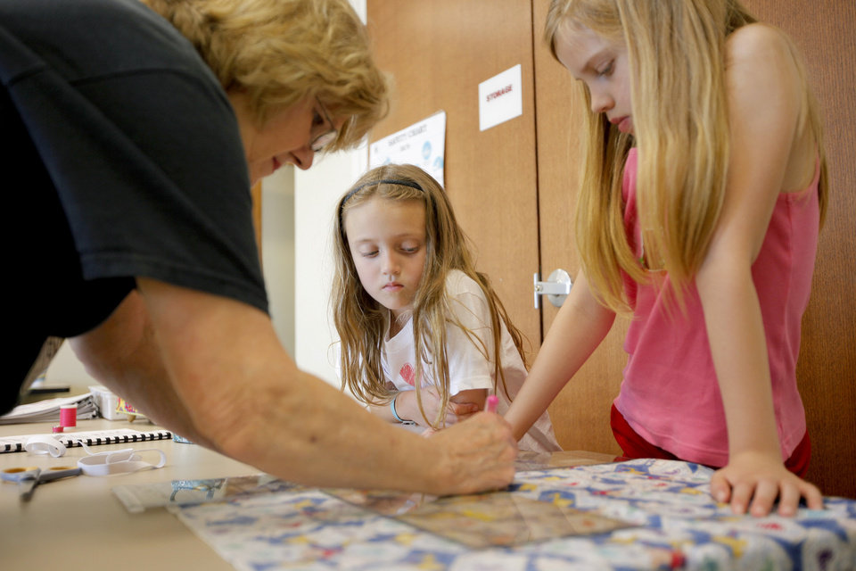 Jeanine Smith helps Jordan Exline, 9, at left, and Jillian Douglass, 9, during a sewing class for kids at the Multi-Activity Center in Edmond, Okla., Tuesday, May 26, 2009. Photo by Bryan Terry, The Oklahoman