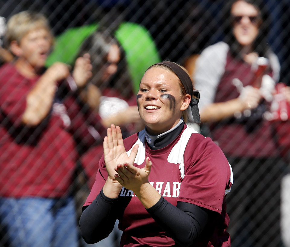 Senior Cheyenne Powell claps as she walks past cheering Blanchard fans on her way to the dugout after her team defeated Tecumseh in Class 4A high school fast-pitch softball championship tournament at the Ball Fields at Firelake in Shawnee on Thursday, Oct. 17, 2013.   Photo by Jim Beckel,  The Oklahoman.