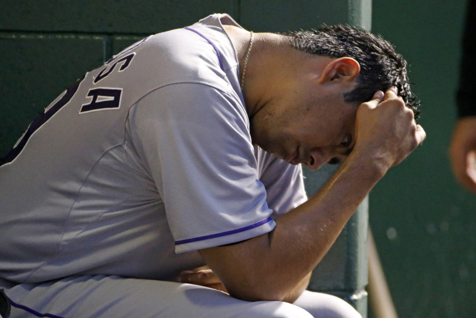 Photo - Colorado Rockies starting pitcher Jorge De La Rosa sits in the dugout during the fifth inning of a baseball game against the Pittsburgh Pirates in Pittsburgh Friday, July 18, 2014. (AP Photo/Gene J. Puskar)