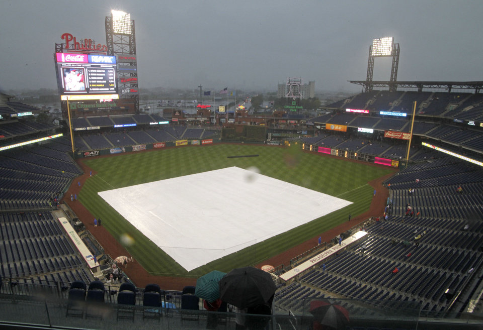 Photo - A tarp covers the infield as rain delays the start of a baseball game between the New York Mets and the Philadelphia Phillies on Tuesday, April 29, 2014, in Philadelphia. (AP Photo/H. Rumph Jr)