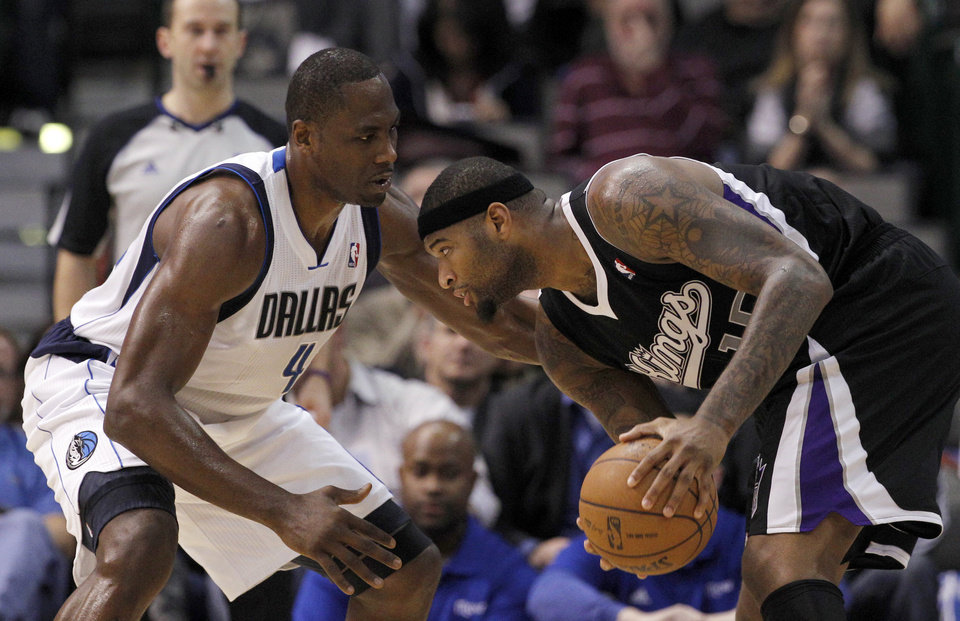 Photo - Dallas Mavericks power forward Elton Brand (42) defends against Sacramento Kings center DeMarcus Cousins (15) in the second half of an NBA basketball game Monday, Dec. 10, 2012, in Dallas. Cousins tied teammate Francisco Garcia with 25-points for team highs in the 119-96 loss to the Mavericks. (AP Photo/Tony Gutierrez)