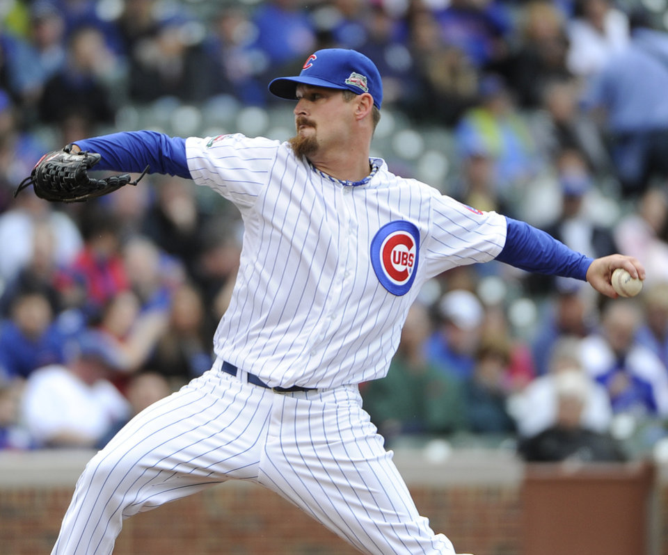 Photo - Chicago Cubs starting pitcher Travis Wood pitches against the Pittsburgh Pirates during the second inning of a baseball game, Thursday, April 10, 2014 in Chicago.  (AP Photo/David Banks)