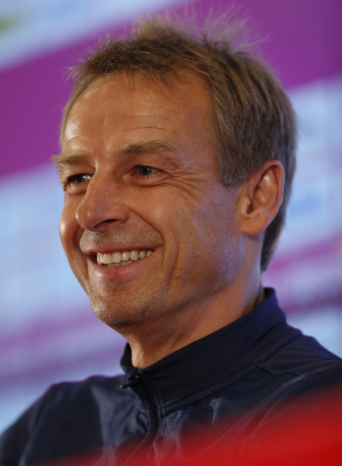 Photo - United States' head coach Jurgen Klinsmann talks during a press conference following a training session in Sao Paulo, Brazil, Tuesday, June 17, 2014.  The United States will play against Portugal in group G of the 2014 soccer World Cup on June 22. (AP Photo/Julio Cortez)