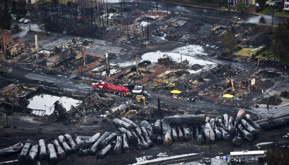 Photo -   Workers comb through debris July 9 after an oil train derailed and exploded in the town of Lac-Megantic, Quebec, killing 47 people.  AP File Photo   Paul Chiasson -