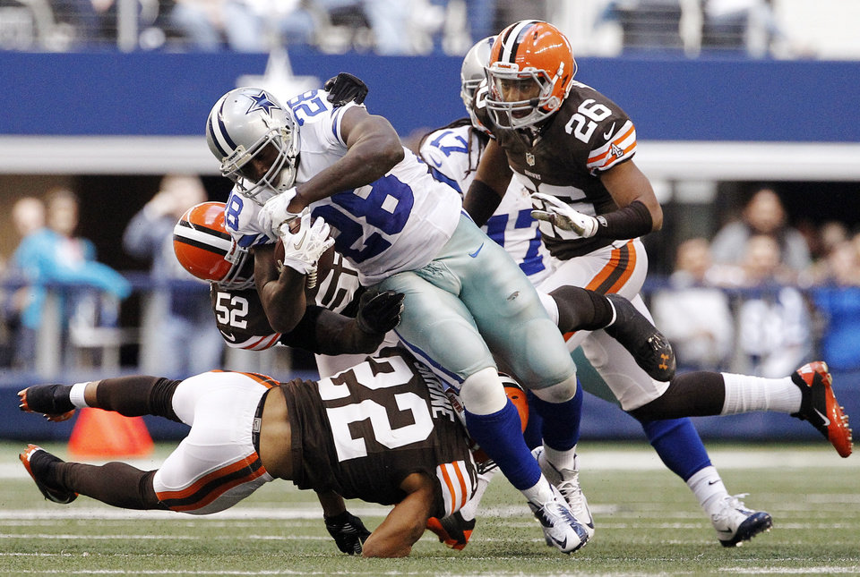 Photo -   Cleveland Browns' Buster Skrine (22), D'Qwell Jackson (52) and Trevin Wade (26) combine to stop a run by Dallas Cowboys' Felix Jones in the second half of an NFL football game, Sunday, Nov. 18, 2012, in Arlington, Texas. (AP Photo/Brandon Wade)