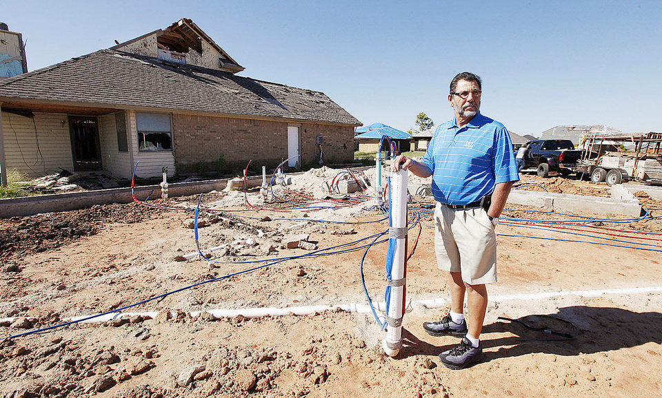 Photo - Marvin Haworth, home builder and developer, stands at the site of a home he is rebuilding at 14500 Briarcliff Drive in the Westmoore addition in south Oklahoma City.  PAUL B. SOUTHERLAND - The Oklahoman