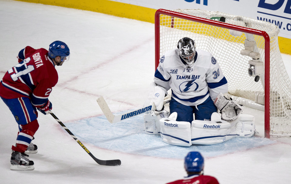 Montreal Canadiens' Brian Gionta scores past Tampa Bay Lightning goaltender Ben Bishop during the second period of their NHL hockey game, Thursday, April 18, 2013, in Montreal. (AP Photo/The Canadian Press, Paul Chiasson)