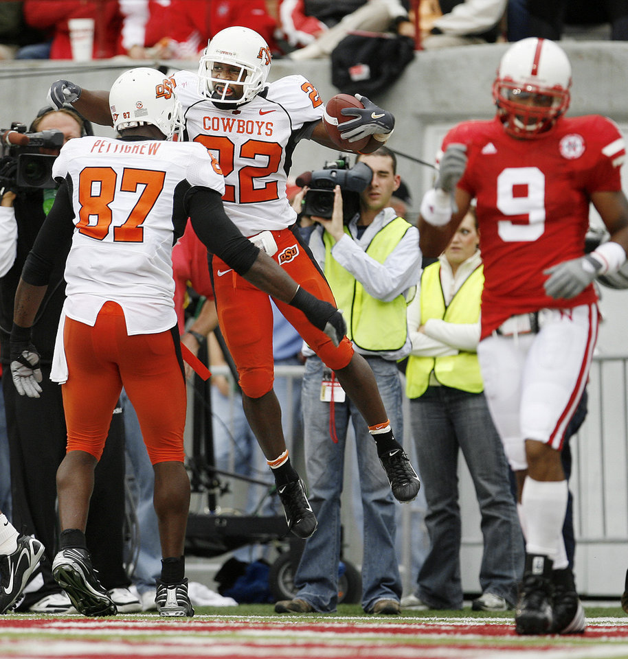 Photo - Dantrell Savage of OSU celebrates his touchdown with Brandon Pettigrew as Bryan Wilson of Nebraska walks off the field during  the college football game between Oklahoma State University (OSU) and the University of Nebraska at Memorial Stadium in Lincoln, Neb., on Saturday, Oct. 13, 2007. By Bryan Terry, The Oklahoman