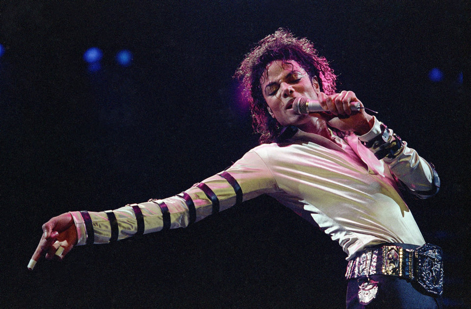 Photo -   In this Feb. 24, 1988 file photo, Michael Jackson leans, points and sings, dances and struts during the opening performance of his 13-city U.S. tour, in Kansas City. More than three years after Michael Jackson's death on June 25, 2009, the validity of the pop superstar's will is being criticized by some of his siblings that it is a fake and the executors of his estate should step down, though experts note that the window to contest the five-page document has long since closed. (AP Photo/Cliff Schiappa, File)