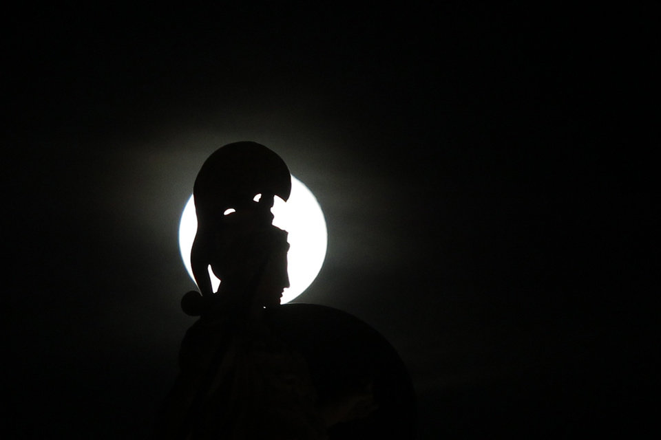 Photo -   A statue of ancient Greek Goddess Athena is silhouetted by the moon, in the center of the Greek capital after elections on Sunday, May 6, 2012. Voters in crisis-hit Greece punished parties that have dominated politics for decades, with parties opposed to the country's bailout agreements gaining ground. (AP Photo/Kostas Tsironis)