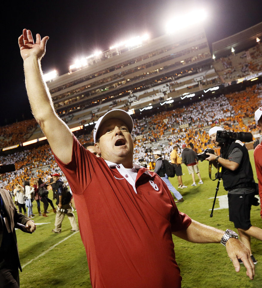 Photo - OU head coach Bob Stoops acknowledges Sooner fans after the college football game between the Oklahoma Sooners (OU) and the Tennessee Volunteers at Neyland Stadium in Knoxville, Tennessee, Saturday, Sept. 12, 2015. OU won 31-24 in double overtime. Photo by Nate Billings, The Oklahoman