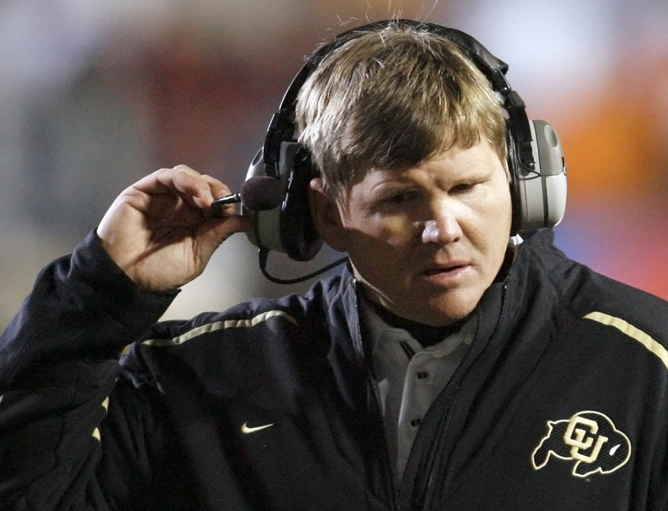 Photo - Colorado head coach Dan Hawkins adjusts his headset in the second half during the college football game between Oklahoma State University and University of Colorado at Folsom Field in Boulder, Colo., Saturday, Nov. 15, 2008. OSU won, 30-17. BY NATE BILLINGS, THE OKLAHOMAN