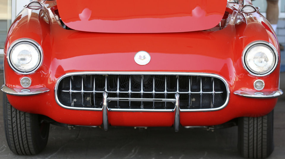 Photo - The grill of a 1956 Chevrolet Corvette on display at Frontier Chevrolet in El Reno, Monday August  25, 2014. Corvette enthusiast made a stop in El Reno on their cross country trip in National Corvette Caravan.  Photo By Steve Gooch, The Oklahoman