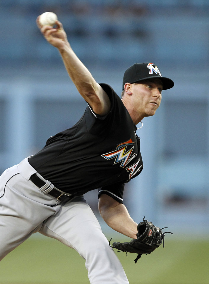 Photo - Miami Marlins starting pitcher Anthony DeSclafani throws against the Los Angeles Dodgers in the first inning of a baseball game Wednesday, May 14, 2014, in Los Angeles. (AP Photo/Alex Gallardo)