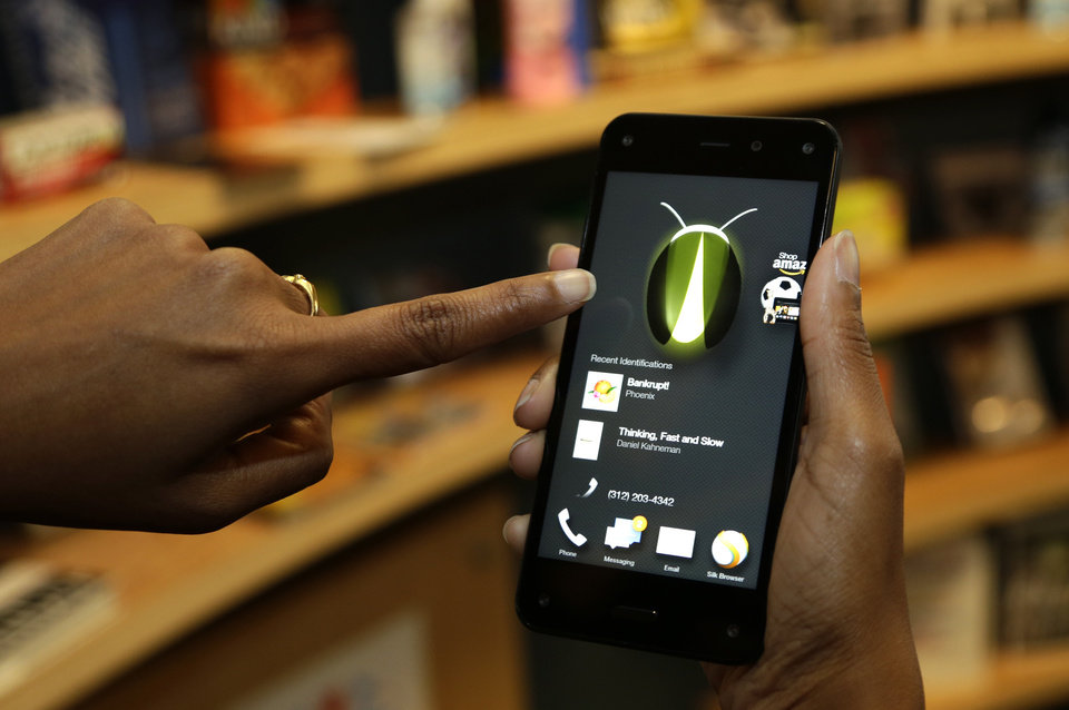 Photo -  This file photo shows the new Amazon Fire Phone's Firefly feature, which lets the user take a photo of objects, numbers, artwork or books and have the phone recognize the item. Firefly also can recognize songs, TV shows, and movies. AP Photo   Ted S. Warren -  AP