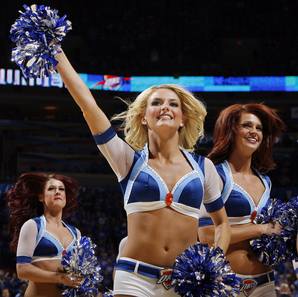 The Thunder Girls leave the court after dancing in the second half during game 7 of the NBA basketball Western Conference semifinals between the Memphis Grizzlies and the Oklahoma City Thunder at the OKC Arena in Oklahoma City, Sunday, May 15, 2011. The Thunder won, 105-90. Photo by Nate Billings, The Oklahoman