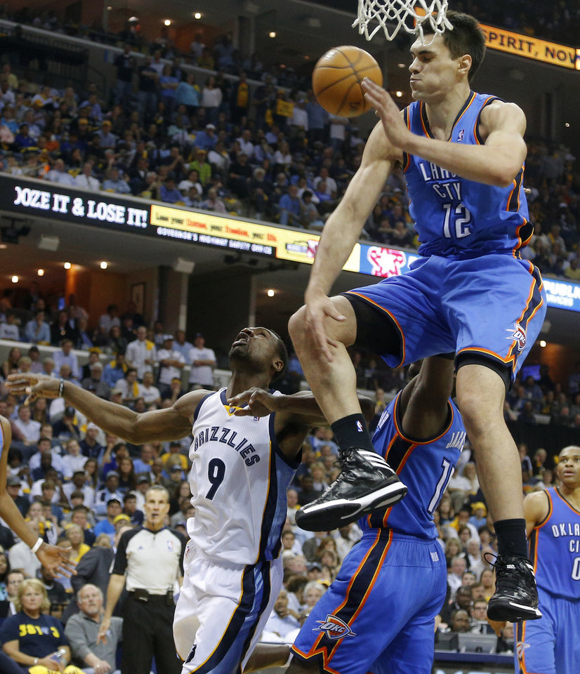 Photo - Oklahoma City's Steven Adams (12) blocks the shot of Memphis' Tony Allen (9) during Game 6 in the first round of the NBA playoffs between the Oklahoma City Thunder and the Memphis Grizzlies at FedExForum in Memphis, Tenn., Thursday, May 1, 2014. Oklahoma City won 104-84. Photo by Bryan Terry, The Oklahoman