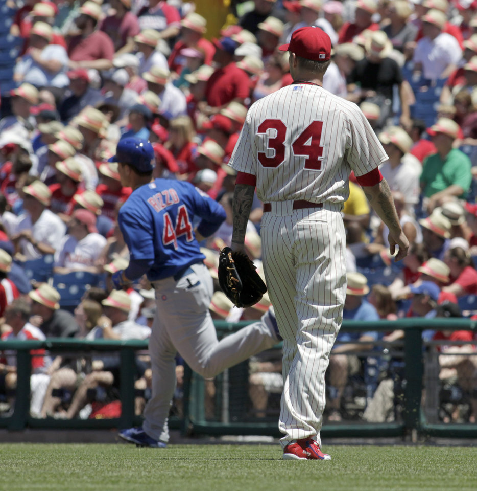 Photo - Philadelphia Phillies starting pitcher A.J. Burnett (34) watches Chicago Cubs' Anthony Rizzo (44) run the bases afterRizzo hit a solo home run in the first inning of a baseball game on Sunday, June 15, 2014, in Philadelphia. (AP Photo/H. Rumph Jr)