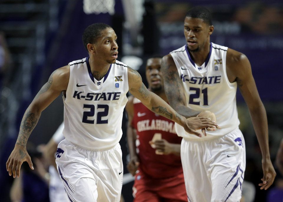 Kansas State guard Rodney McGruder (22) and forward Jordan Henriquez (21) celebrate after McGruder made a basket during the first half of an NCAA college basketball game against the Oklahoma Saturday, Jan. 19, 2013, in Manhattan, Kan. (AP Photo/Charlie Riedel) ORG XMIT: KSCR113