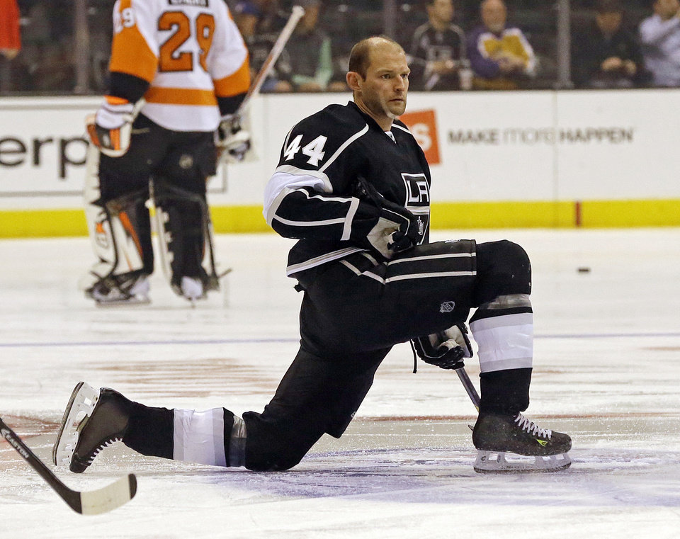 Photo - Los Angeles Kings defenseman Robyn Regehr (44) warms up before his 1,000th NHL regular season NHL hockey game against the Philadelphia Flyers in Los Angeles Saturday, Feb. 1, 2014.  (AP Photo/Reed Saxon)