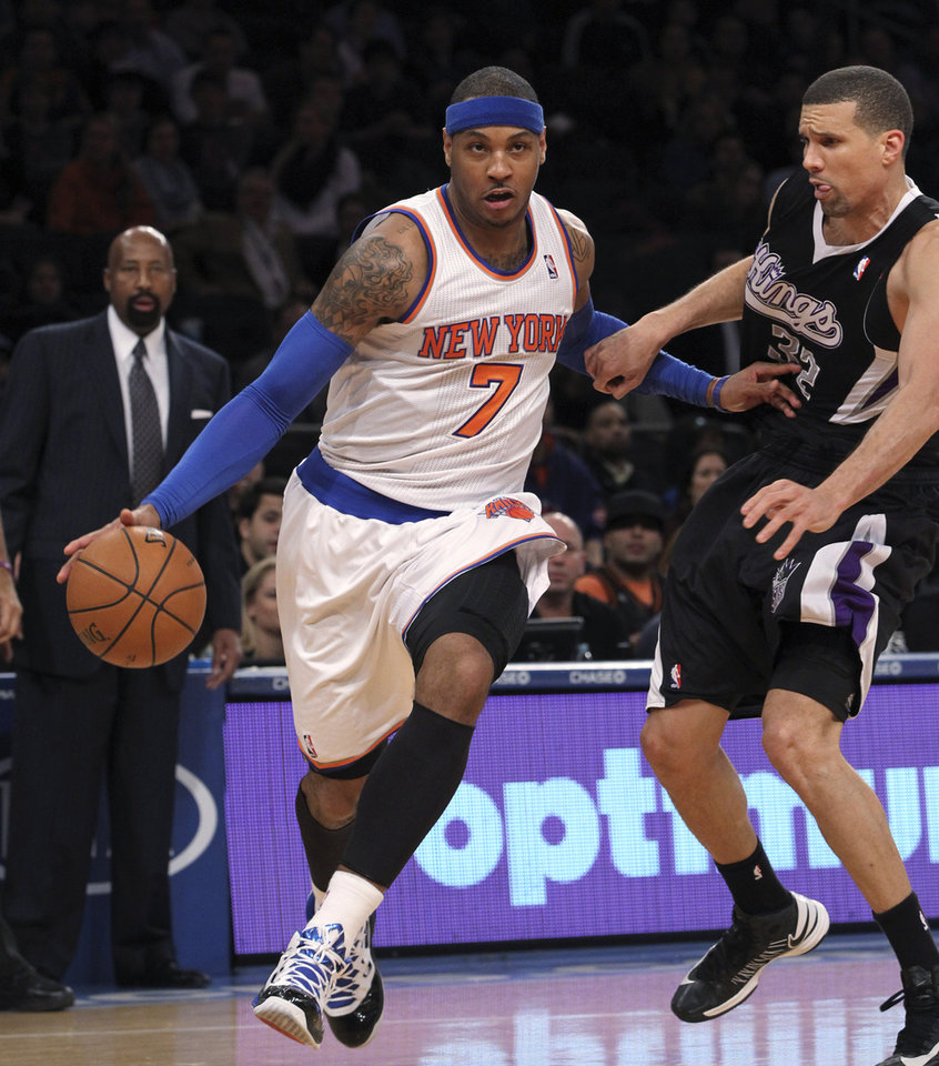 New York Knicks\' Carmelo Anthony (7) drives past Sacramento Kings\' Francisco Garcia during the first half of NBA basketball game, Saturday, Feb. 2, 2013, at Madison Square Garden in New York.(AP Photo/Mary Altaffer)