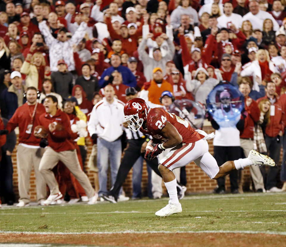 Oklahoma\'s Brennan Clay (24) rushes for the game-winning touchdown in overtime during the Bedlam college football game between the University of Oklahoma Sooners (OU) and the Oklahoma State University Cowboys (OSU) at Gaylord Family-Oklahoma Memorial Stadium in Norman, Okla., Saturday, Nov. 24, 2012. OU won, 51-48 in overtime. Photo by Nate Billings , The Oklahoman