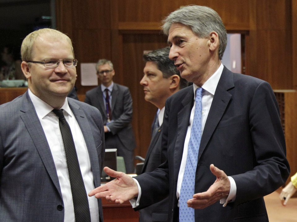 Photo - British Foreign Secretary Philip Hammond, right, talks with Estonia's Foreign Minister Urmas Paet during an EU foreign ministers council at the European Council building in Brussels, Tuesday, July 22, 2014. European Union foreign ministers are meeting to consider further sanctions against Russia because of the downing of a Malaysian jetliner, with Britain and some other countries demanding much tougher measures. (AP Photo/Yves Logghe)