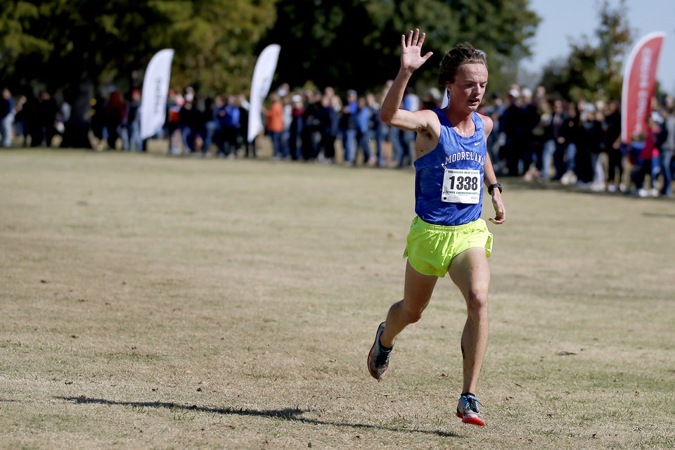 Photo - Mooreland's Collen Mclain waves to the crowd as he wins the Class 2A cross country state meet Saturday in Shawnee. [Bryan Terry/The Oklahoman]