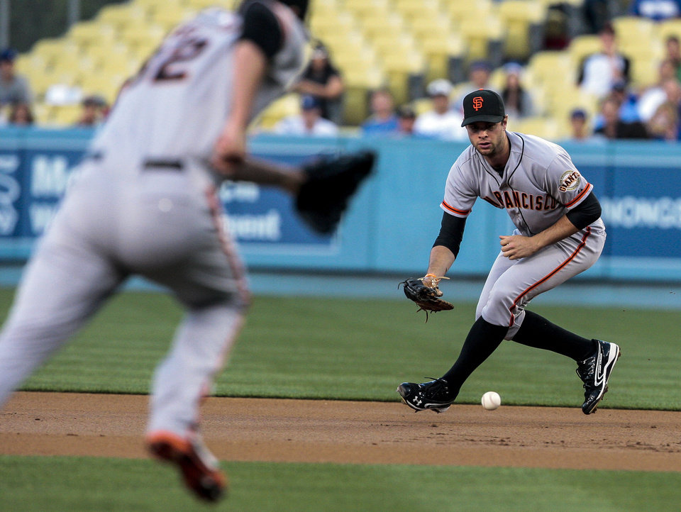 Photo -   San Francisco Giants first baseman Brandon Belt makes a play on a ground ball during the first inning of a baseball game, Tuesday against the Los Angeles Dodgers, May 8, 2012, in Los Angeles. (AP Photo/Bret Hartman)