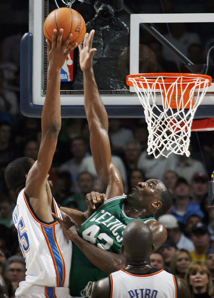 Photo - Boston's Kendrick Perkins blocks the shot of Oklahoma City's Kevin Durant in the second half during the NBA basketball game between the Oklahoma City Thunder and the Boston Celtics at the Ford Center in Oklahoma City, Wednesday, Nov. 5, 2008. Boston won, 96-83. BY NATE BILLINGS, THE OKLAHOMAN