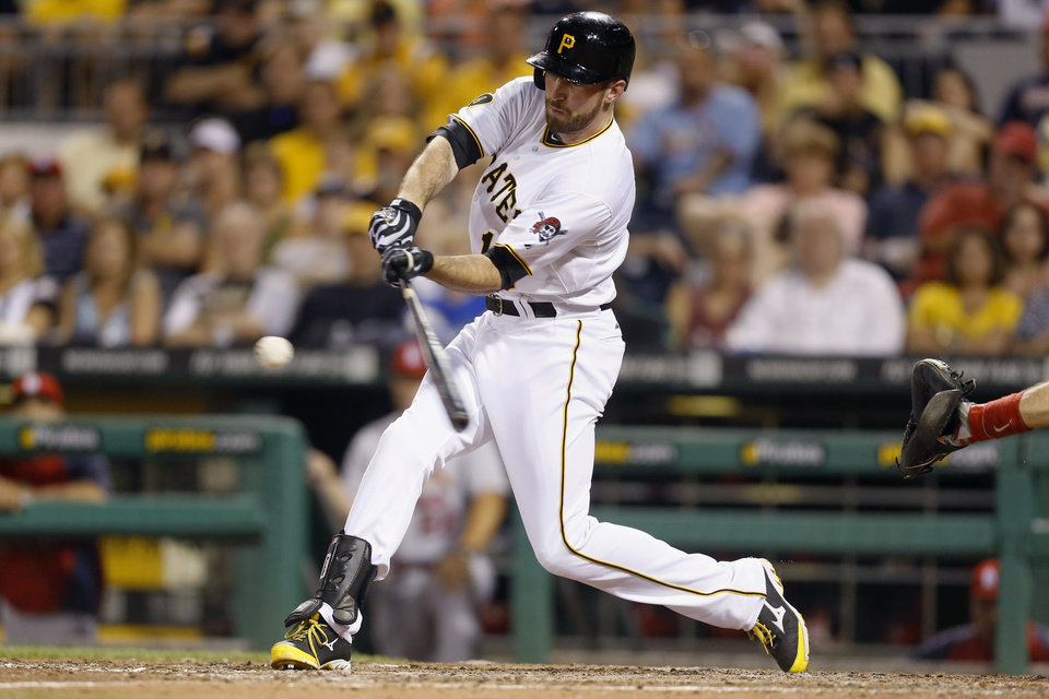Photo - Pittsburgh Pirates' pinch-hitter Ike Davis hits a three-run home run to give his team the lead in the seventh inning of the baseball game against the St. Louis Cardinals on Tuesday, Aug. 26, 2014, in Pittsburgh. The runs proved to be the margin of victory as the Pirates won 5-2. (AP Photo/Keith Srakocic)
