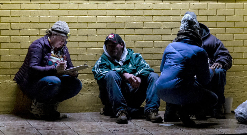 Photo - Amy Newberry, left, interviews a homeless person during the city's annual Point-in-Time homeless count in Oklahoma City, Okla. on Thursday, Jan. 23, 2020.   [Chris Landsberger/The Oklahoman]