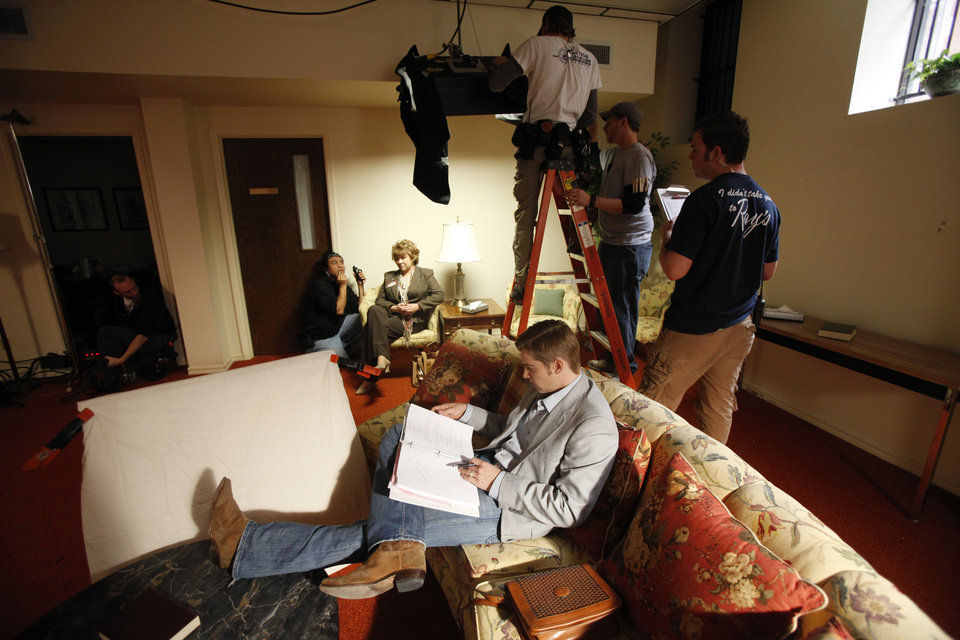 Photo - FILM: Actor Mike Vogel, who portrays Brooks Douglass, looks at his script during a break on the set of