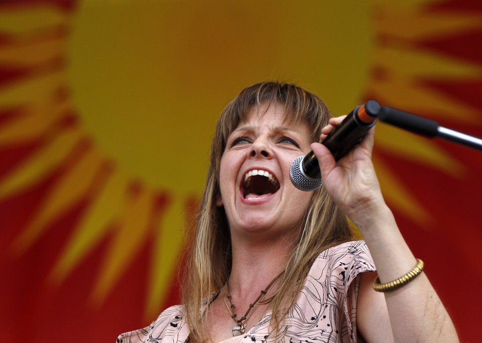 Photo -   CORRECTS SPELLING OF FIRST NAME TO ALLEN INSTEAD OF ALLAN - Theresa Andersson performs with Allen Toussaint at the New Orleans Jazz and Heritage Festival in New Orleans, Saturday, May 5, 2012. (AP Photo/Gerald Herbert)