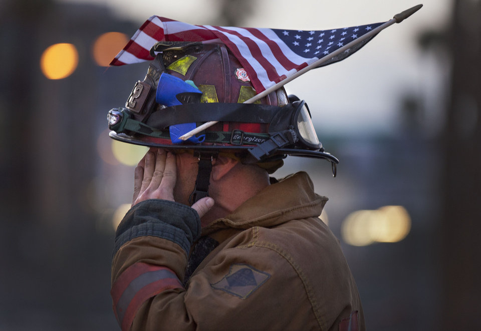 Las Vegas firefighter Capt. Eric Littmann walks in a parade commemorating the 2001 attacks on the World Trade Center and the Pentagon, Sunday, Sept. 11, 2011, in Las Vegas. ( AP Photo/Julie Jacobson)