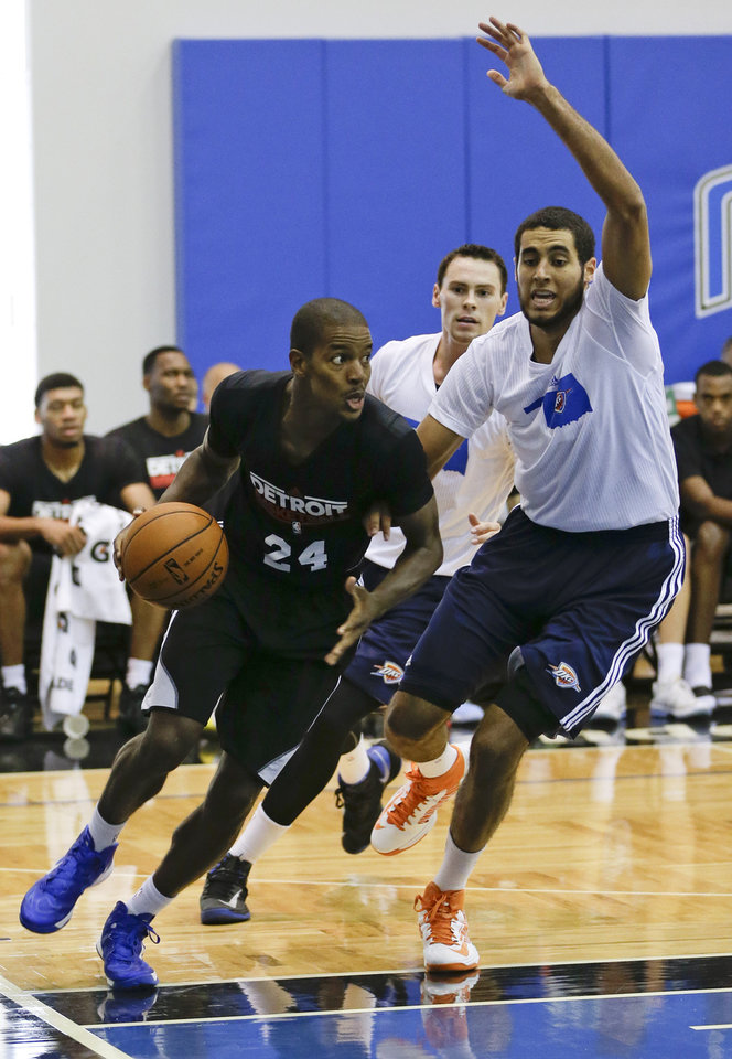 Photo - Detroit Pistons' Kim English (24) drives the baseline past Oklahoma City Thunder's Grant Jerrett, right, during an NBA summer league basketball game, Tuesday, July 9, 2013, in Orlando, Fla. (AP Photo/John Raoux) ORG XMIT: DOA114