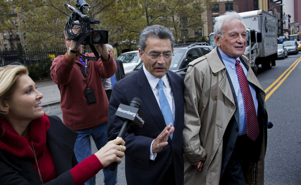 Photo -   Former Goldman Sachs and Procter & Gamble Co. board member Rajat Gupta, center, declines to answer a question from a reporter as he arrives outside federal court in New York Wednesday, Oct. 24, 2012. Gupta is to be sentenced after being found guilty insider trading by passing secrets between March 2007 and January 2009 to a billionaire hedge fund founder who used the information to make millions of dollars. At right is Gupta's attorney Gary Naftalis. (AP Photo/Craig Ruttle)