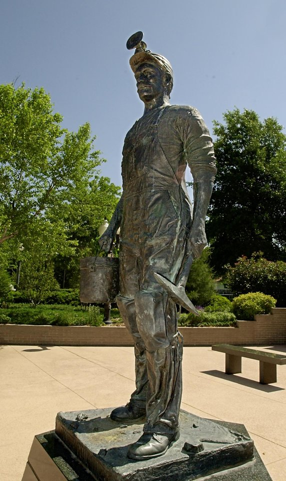Photo -  Pioneer Miner statue in the Coal Miners Memorial Plaza in Cadick Park in McAlester. A plaque on the statue reminds visitors that death and black lung disease were among the hazards miners faced. Oklahoman Photo by David McDaniel   DAVID MCDANIEL