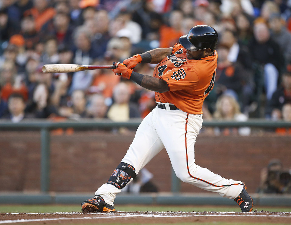 Photo - San Francisco Giants' Pablo Sandoval hits a three-run home run off Minnesota Twins starting pitcher Kyle Gibson in the first inning of a baseball game Friday, May 23, 2014, in San Francisco. (AP Photo/Tony Avelar)