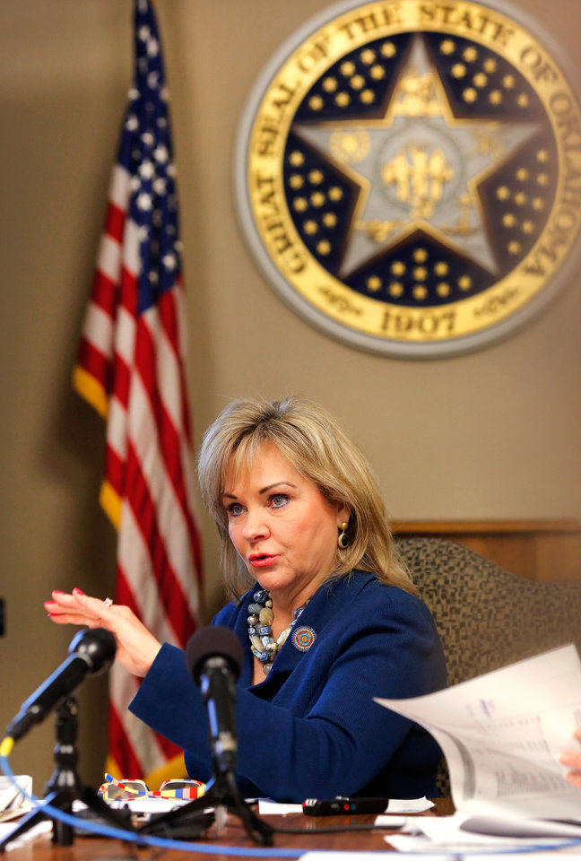 Photo - Gov. Mary Fallin asks a question during the meeting. Board of Equalization gathered to hear a finance report by Preston Doerflinger, Director and Secretary of Finance, Administration and Information Technology, Tuesday, Feb. 16, 2016, in the governorÕs large conference room at the state Capitol. Doerflinger also serves as the director of the Office of Management and Enterprise Services (OMES), the stateÕs central finance and operations agency.Photo by Jim Beckel, The Oklahoman.