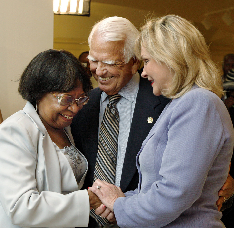 Photo - Oklahoma Gov. Mary Fallin, right, and former governor, George Nigh, greet Marilyn Luper Hildreth as they express condolences to members of the Luper family. Oklahoma civil rights leader  Clara Luper was honored by the state as her body lay in repose on the first floor of the State Capitol, Thursday, June 16, 2011. Her dark wood casket remained closed as a pair of Oklahoma Highway Patrol troopers stood silently on either side of the casket.    Luper died in Oklahoma City last week. Photo by Jim Beckel, The Oklahoman
