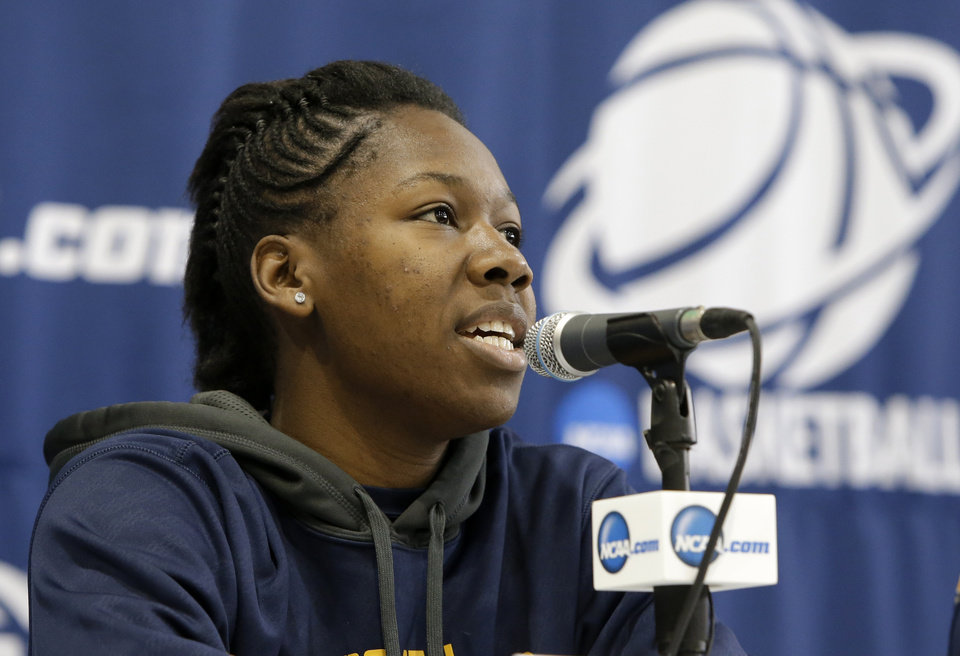 Photo - California's Afure Jemerigbe responds to a a question during an NCAA college basketball tournament news conference, Sunday, March 23, 2014, in Waco, Texas. California is scheduled to play Baylor Monday. (AP Photo/Tony Gutierrez)