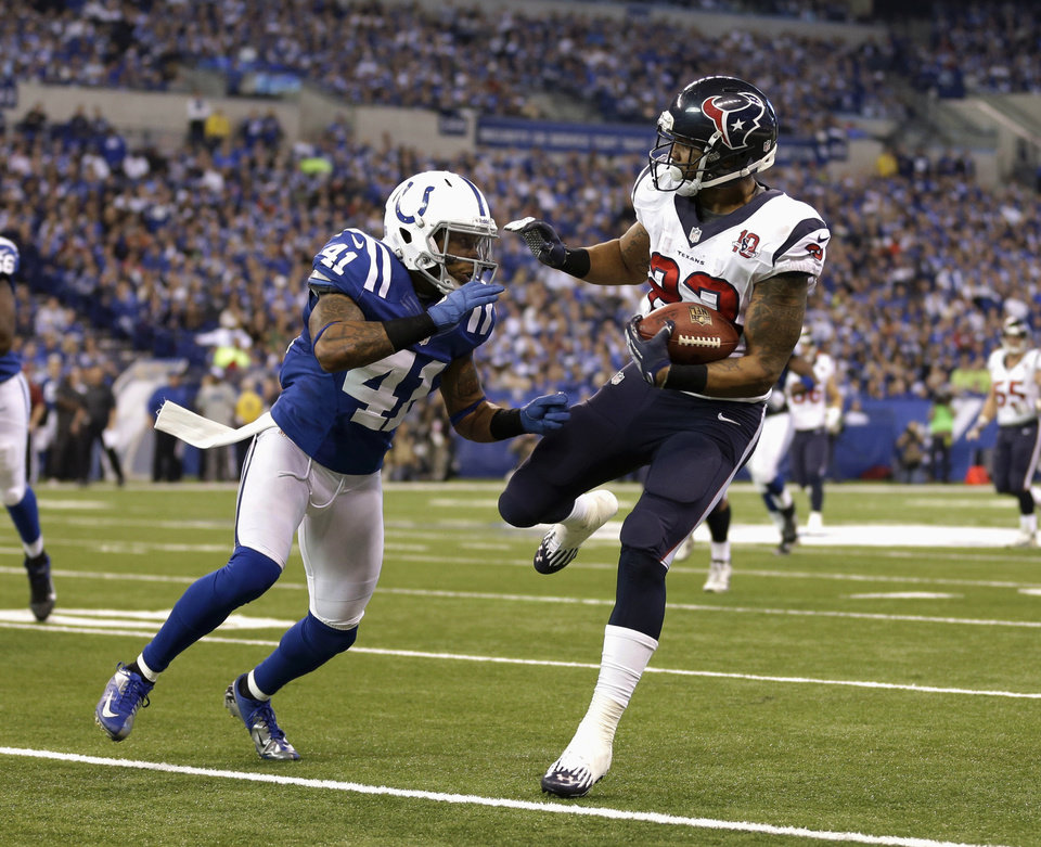 Photo - Houston Texans' Arian Foster (23) runs against Indianapolis Colts' Antoine Bethea during the second half of an NFL football game, Sunday, Dec. 30, 2012, in Indianapolis. (AP Photo/Michael Conroy)